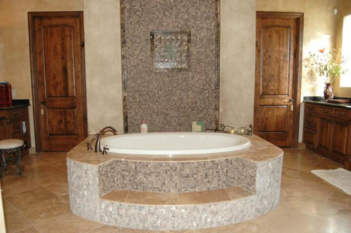 This is a simple Kohler bathtub dropped into a mosaic tile surround